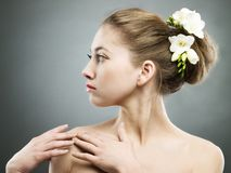 Girl with freesia Royalty Free Stock Photo