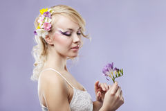 Girl with freesia Stock Photography