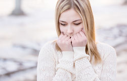 Girl freezing in the park Stock Photography