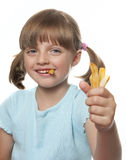 Girl with french fries Stock Image