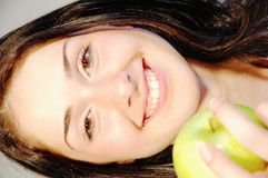 Girl with fresh apple 2 Royalty Free Stock Photography