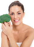 Girl with fresh broccoli Royalty Free Stock Image