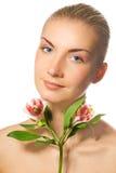 Girl with fresh flower Stock Photos