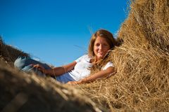 Girl on fresh hay Stock Photo