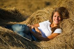 Girl on fresh hay Stock Photography
