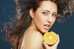 Girl with fresh juicy orange Stock Images
