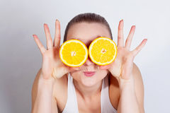 Girl with fresh orange Royalty Free Stock Images