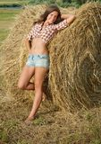 Girl on fresh straw Stock Image