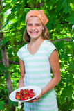 Girl with fresh strawberries Royalty Free Stock Photos