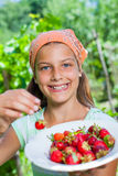 Girl with fresh strawberries Stock Images