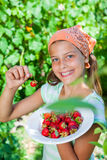 Girl with fresh strawberries Royalty Free Stock Image