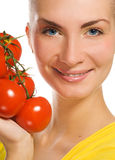 Girl with fresh tomatoes Royalty Free Stock Photo