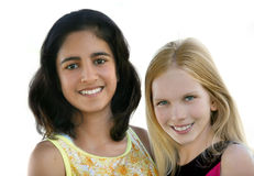 Girl friends. Two happy teen girls - indian and caucasian Stock Images