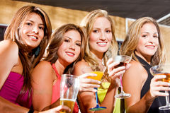 Girl friends in a bar Royalty Free Stock Image