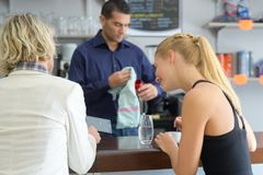 Girl friends at bar cafeteria Royalty Free Stock Photography