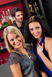 Girl friends at the bar hugging together Royalty Free Stock Photography