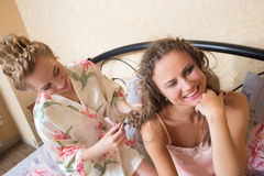 Girl friends blond attractive young women sitting Royalty Free Stock Photos