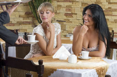 Girl friends in a cafe Stock Photo