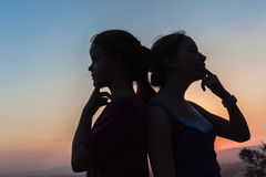 Girl Friends Decisions Silhouetted Stock Photo