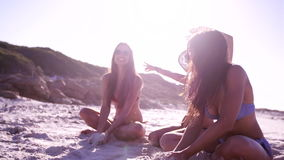 Girl friends enjoying holidays on the sea shore stock footage