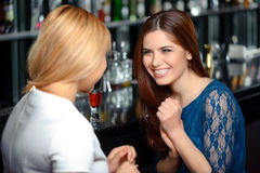 Girl friends have a drink in the bar Royalty Free Stock Photo