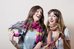 Girl friends having fun wearing knitted scarfs Royalty Free Stock Photos