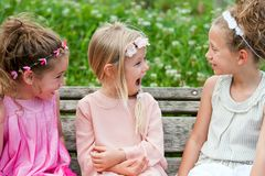 Girl friends having a laugh in park. Stock Photography