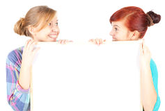 Girl friends holding blank paper Stock Photography