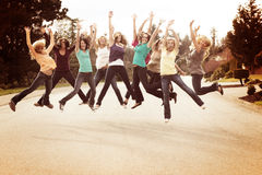 Girl friends jumping for joy Stock Photography
