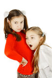 Girl friends listen to the heartbeat Stock Photography