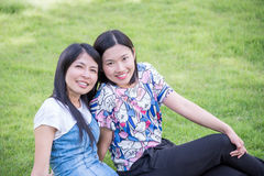Girl friends in park Royalty Free Stock Image
