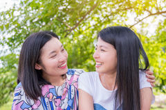 Girl friends in park Royalty Free Stock Photo