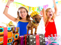 Girl friends party dancing with presents and puppy Stock Photos