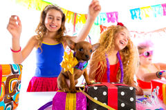 Girl friends party dancing with presents and puppy Stock Image