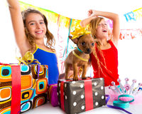Girl friends party dancing with presents and puppy Stock Photo