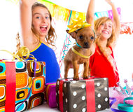 Girl friends party dancing with presents and puppy Stock Photography