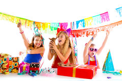 Girl friends party dancing with puppy dog present Stock Image