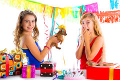 Girl friends party excited with puppy dog present. Girl friends party excited with puppy chihuahua present dog in birthday royalty free stock image