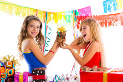 Girl friends party excited with puppy dog present Stock Photo