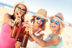 Girl friends on picnic on the beach Royalty Free Stock Photography
