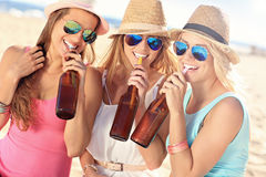 Girl friends on picnic on the beach Royalty Free Stock Images