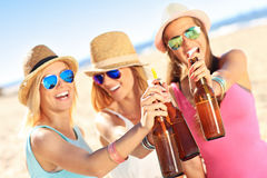 Girl friends on picnic on the beach Royalty Free Stock Photos