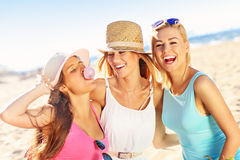 Girl friends on picnic on the beach. A picture of a group of friends drinking beer on the beach Royalty Free Stock Photos
