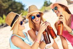 Girl friends on picnic on the beach Stock Photo