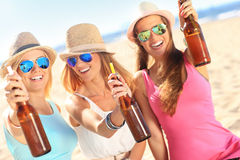 Girl friends on picnic on the beach Stock Image