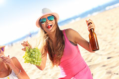 Girl friends on picnic on the beach Stock Images