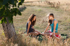 Girl friends on a picnic Stock Image