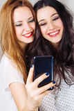 Girl friends posing for a selfie Royalty Free Stock Photography