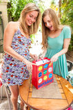 Girl friends receiving gifts Royalty Free Stock Photo