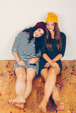Girl friends resting after a party a party Royalty Free Stock Photo